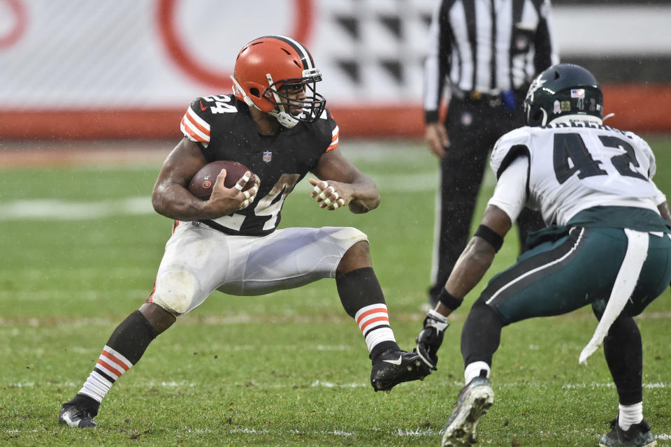 Cleveland Browns running back Nick Chubb (24) rushes against Philadelphia Eagles safety K'Von Wallace (42) during the second half of an NFL football game, Sunday, Nov. 22, 2020, in Cleveland. (AP Photo/David Richard)
