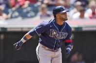 Tampa Bay Rays' Nelson Cruz watches his solo home run in the sixth inning of a baseball game against the Cleveland Indians, Sunday, July 25, 2021, in Cleveland. (AP Photo/Tony Dejak)