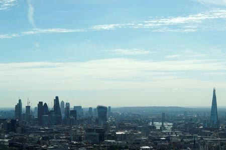 FILE PHOTO:  A view of the City of London, Canary Wharf and the Shard