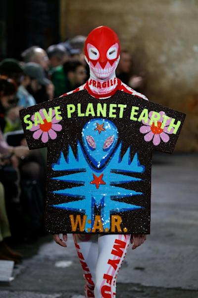 Fashion alert: Belgian designer Walter Van Beirendonck, who has been highly critical of the fashion industry, used his Paris men's fashion week show to call for action on the environment