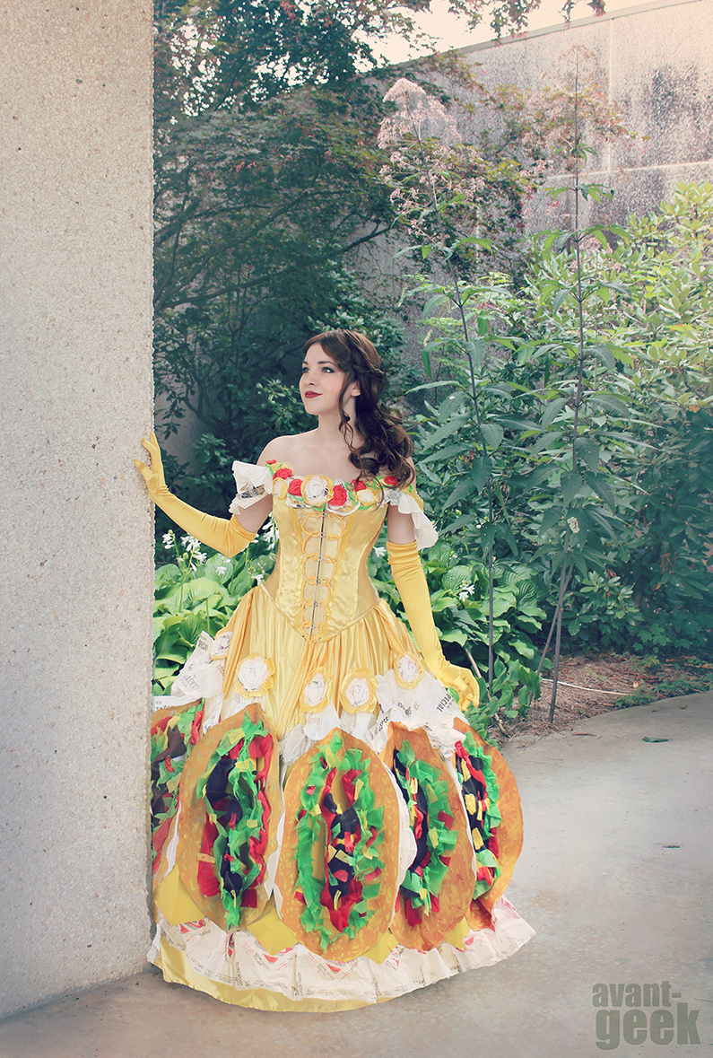 """<p>Avant-Geek's artistic take on this pun is pretty advanced, but you can achieve a similar look using a store-bought Belle costume and assorted felt.</p><p><strong>See more at <a href=""""https://www.tacobell.com/blog/OliviaMearsFeedArticlePage"""" rel=""""nofollow noopener"""" target=""""_blank"""" data-ylk=""""slk:Taco Bell"""" class=""""link rapid-noclick-resp"""">Taco Bell</a>.</strong></p><p><strong><a class=""""link rapid-noclick-resp"""" href=""""https://www.amazon.com/Fabric-Assorted-Squares-Nonwoven-Patchwork/dp/B06XSW7TR2/?tag=syn-yahoo-20&ascsubtag=%5Bartid%7C10050.g.21600836%5Bsrc%7Cyahoo-us"""" rel=""""nofollow noopener"""" target=""""_blank"""" data-ylk=""""slk:SHOP ASSORTED FELT"""">SHOP ASSORTED FELT</a></strong></p>"""