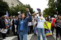 LGBTQ activists and supporters hold rally near the steps of the Supreme Court as it hears major LGBT rights case in Washington