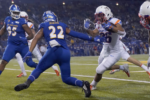 FILE - In this Saturday, Nov. 2, 2019 file photo, Boise State's Avery Williams (26) races past San Jose State's Tre Jenkins (22) on his punt return for a touchdown during the first half of an NCAA college football game, in San Jose, Calif. No. 25 San Jose State will face perennial conference powerhouse Boise State in the Mountain West championship on Saturday, Dec. 19, 2020 in Las Vegas. The game is usually played on the higher seeds home field but this year it will be held at Sam Boyd Stadium. (AP Photo/Tony Avelar, File)