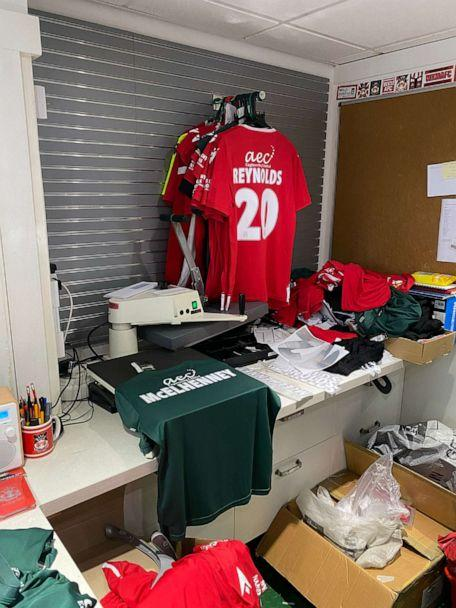 PHOTO: In the club shop, Wrexham soccer jerseys are being sold with 'Reynolds' and McElhenney' on the back. (ABC News)
