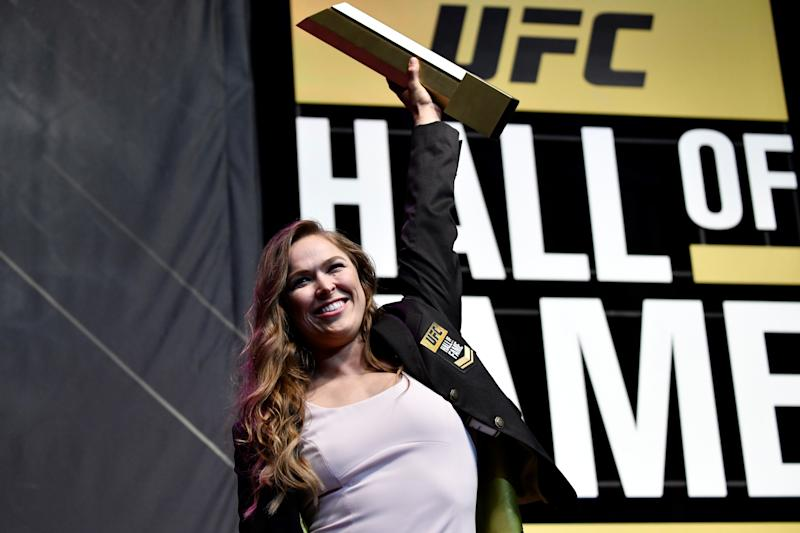 Ronda Rousey poses with her trophy after her induction into the UFC Hall of Fame.