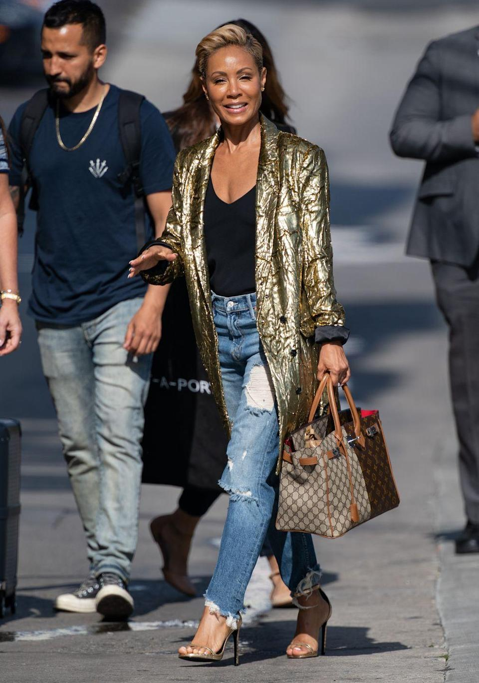 <p>Metallics are definitely having a moment. We love the high/low treatment Jada Pinkett Smith is giving this gold number. Shine on! </p>