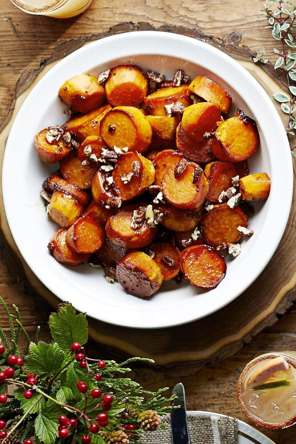 """<p>A staple sweetener in the South, sorghum makes for a delicious glaze on baked sweet potatoes.</p><p><em><a href=""""https://www.goodhousekeeping.com/food-recipes/a16043/sorghum-sweet-potatoes-recipe-clx1114/"""" rel=""""nofollow noopener"""" target=""""_blank"""" data-ylk=""""slk:Get the recipe for Sorghum-Glazed Sweet Potatoes »"""" class=""""link rapid-noclick-resp"""">Get the recipe for Sorghum-Glazed Sweet Potatoes »</a></em></p>"""