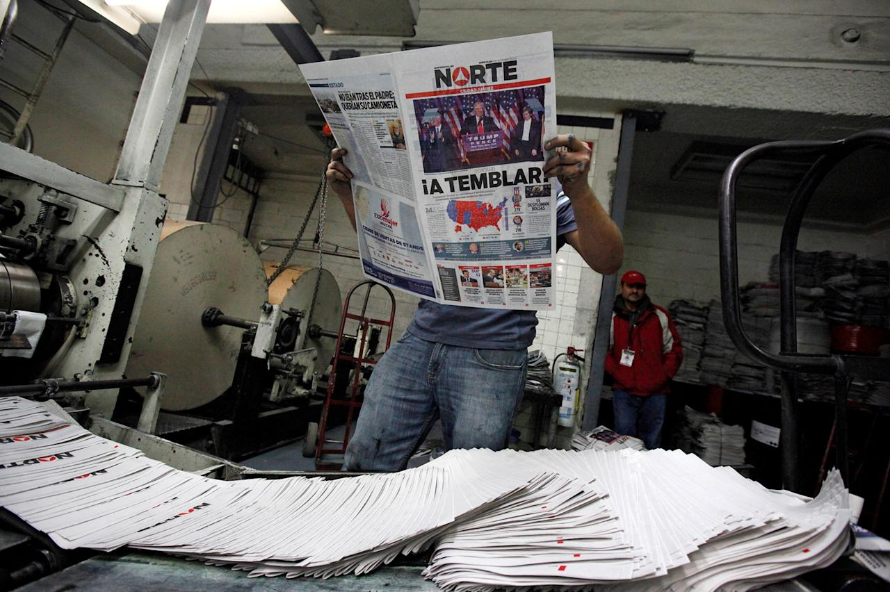 """<p>A worker reads a freshly printed newspaper with the headline reading """"We will tremble"""" at a printer of the local daily Norte in Ciudad Juarez, Mexico on Nov. 9, 2016. (Photo: Jose Luis Gonzalez/Reuters) </p>"""