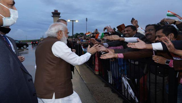 Modi received a warm welcome from the members of the Indian community at Joint Base Andrews in Washington DC. He stepped out of his motorcade to interact with the Indians waiting at the airport. The crowd was chanting his name and waving the Indian flag amid light showers. The prime minister was seen smiling and shaking handing with the members of the Indian community. Image Courtesy: @narendramodi/Twitter