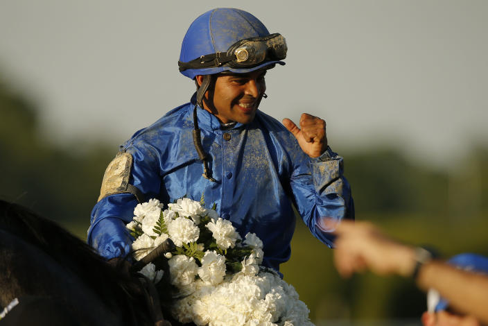Jockey Luis Saez celebrates after winning the 153rd running of the Belmont Stakes horse race with Essential Quality (2), Saturday, June 5, 2021, At Belmont Park in Elmont, N.Y. (AP Photo/Eduardo Munoz Alvarez)