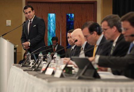 Puerto Rico's Governor Ricardo Rossello (L) addresses the audience during a meeting of the Financial Oversight and Management Board for Puerto Rico at the Convention Center in San Juan, Puerto Rico March 31, 2017. Picture taken March 31, 2017. REUTERS/Alvin Baez