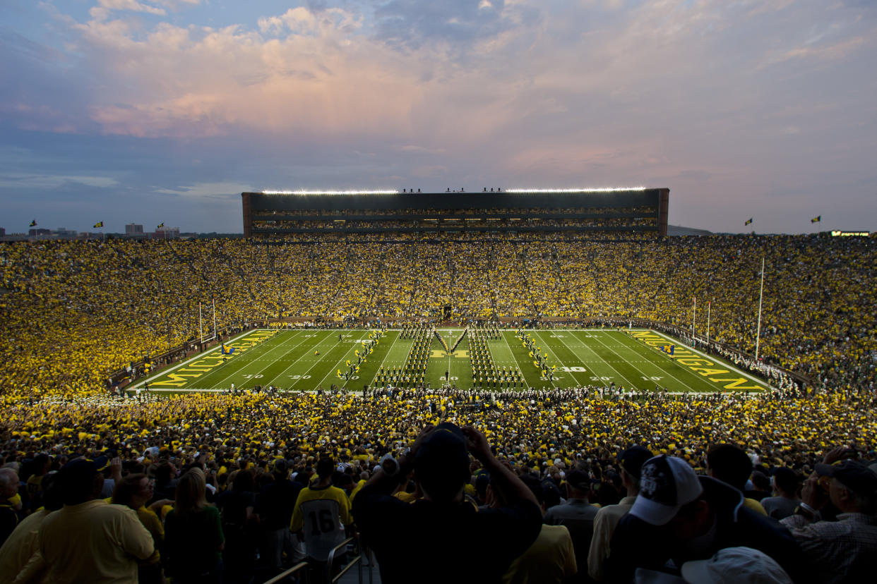 The Michigan Marching Band performs before an NCAA college football game with Notre Dame at Michigan Stadium, in Ann Arbor, Mich., Saturday, Sept. 7, 2013. This is only the second ever night game played at Michigan Stadium. Michigan won 41-30. (AP Photo/Tony Ding)