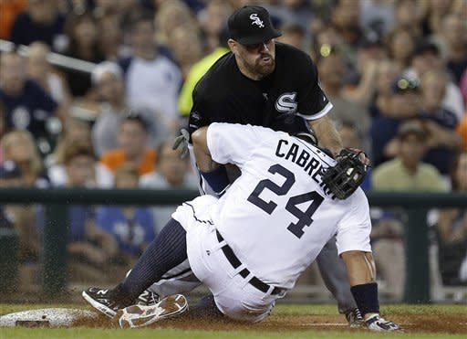 Detroit Tigers' Miguel Cabrera (24) slides safely into third base under the tag of Chicago White Sox third baseman Kevin Youkilis (20) in the fifth inning of a baseball game in Detroit, Friday, Aug. 31, 2012. (AP Photo/Paul Sancya)