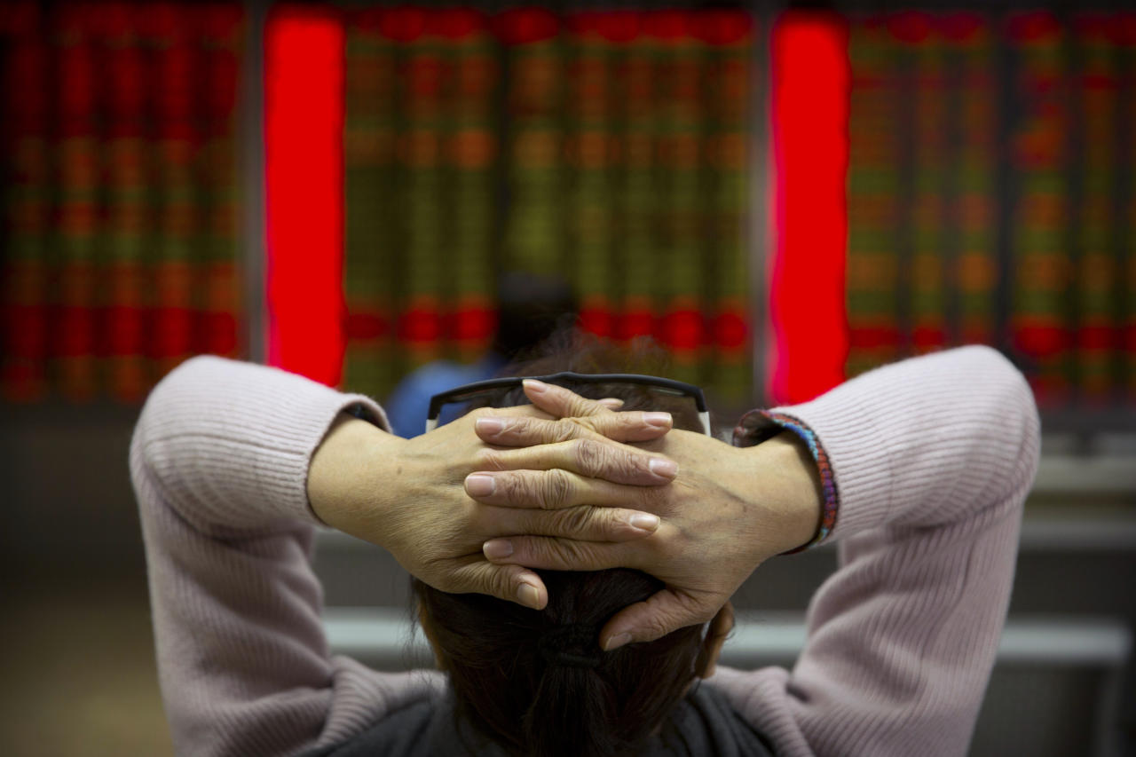 A Chinese investor monitors stock prices at a brokerage house in Beijing, Friday, Feb. 23, 2018. Asian stocks advanced Friday after Wall Street rebounded from a two-day losing streak and Japanese inflation edged higher. (AP Photo/Mark Schiefelbein)