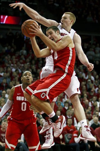 Ohio State's Aaron Craft, front, shoots against Wisconsin's Mike Bruesewitz, top, during the first half of an NCAA college basketball game Saturday, Feb. 4, 2012, in Madison, Wis. (AP Photo/Andy Manis)