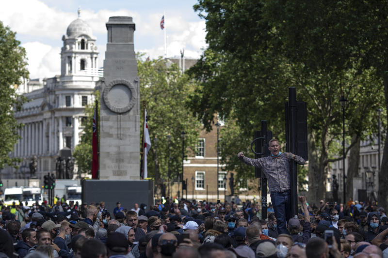 LONDON, ENGLAND - JUNE 13: Activists gather on Whitehall as far-right linked groups gather around London's statues on June 13, 2020 in London, United Kingdom. Following a social media post by the far-right activist known as Tommy Robinson, members of far-right linked groups have gathered around statues in London. Several statues in the UK have been targeted by Black Lives Matter protesters for their links to racism and the slave trade. (Photo by Dan Kitwood/Getty Images)