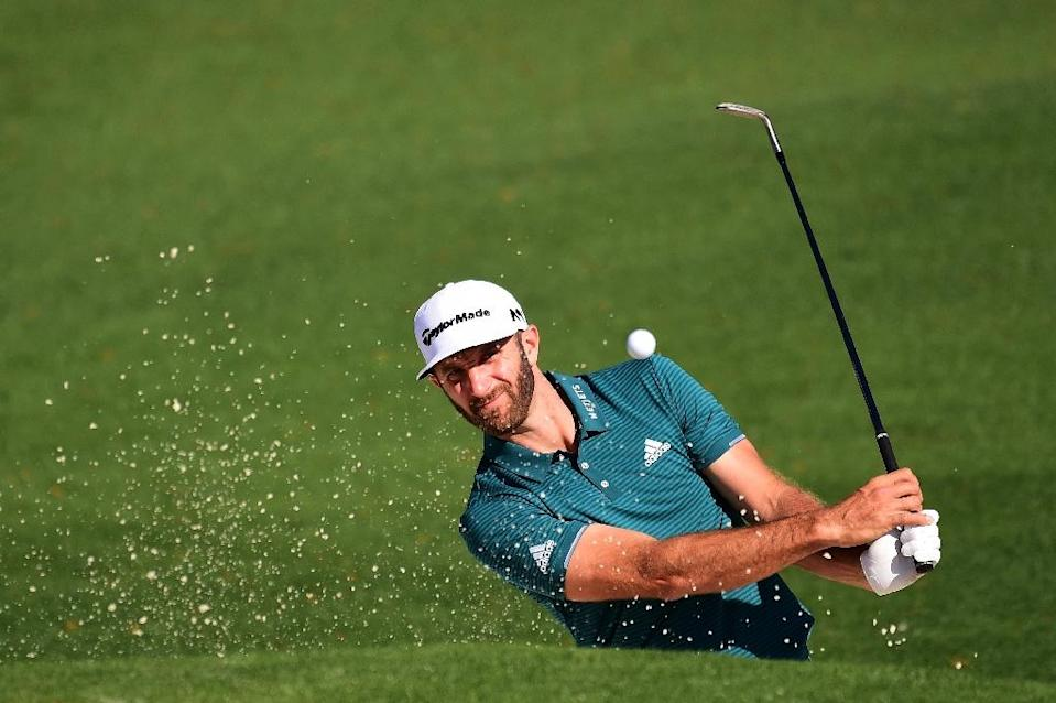 Dustin Johnson of the US plays a shot from a bunker on the second hole during a practice round prior to the start of the 2017 Masters Tournament, at Augusta National Golf Club in Georgia, on April 4 (AFP Photo/Harry How)