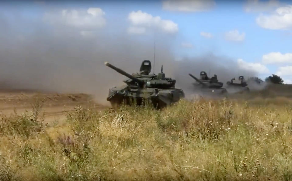 <em>Tanks roll during the military exercises in the Chita region (AP)</em>