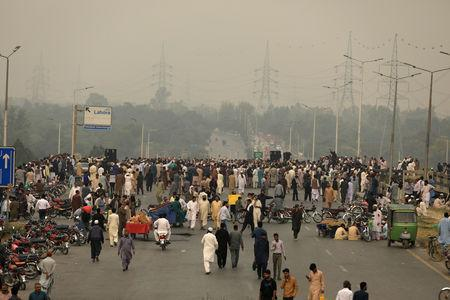 Supporters of the Tehrik-e-Labaik Pakistan Islamist political party block the Faizabad junction to protest in Islamabad