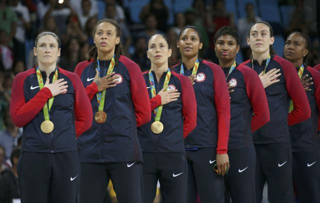 2016 Rio Olympics - Basketball - Final - Women's Gold Medal Game USA v Spain - Carioca Arena 1 - Rio de Janeiro, Brazil - 20/8/2016. Lindsay Whalen (USA) of USA, Seimone Augustus (USA) of USA, Sue Bird (USA) of USA Maya Moore (USA) of USA, Angel McCoughtry (USA) of USA, Breanna Stewart (USA) of USA and Tamika Catchings (USA) of USA (L to R) stand for the playing of the U.S. National Anthem during the medal presentation ceremony for the women's basketball top finishers. REUTERS/Shannon Stapleton FOR EDITORIAL USE ONLY. NOT FOR SALE FOR MARKETING OR ADVERTISING CAMPAIGNS.