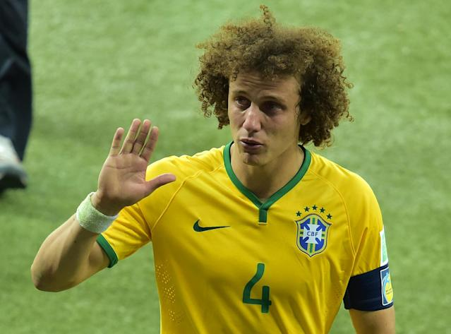 Brazil's defender David Luiz leaves the pitch after the World Cup match against Germany in Belo Horizonte on July 8, 2014 (AFP Photo/Gabriel Bouys)