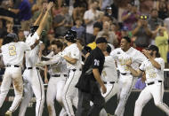 Vanderbilt players celebrate their 6-5 win against Stanford during a baseball game in the College World Series Wednesday, June 23, 2021, at TD Ameritrade Park in Omaha, Neb. (AP Photo/Rebecca S. Gratz)