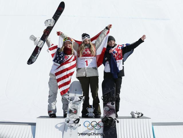 Snowboarding - Pyeongchang 2018 Winter Olympics - Women's Big Air Final Run 3 - Alpensia Ski Jumping Centre - Pyeongchang, South Korea - February 22, 2018 - Gold medallist Anna Gasser of Austria flanked by silver medallist Jamie Anderson of the U.S. and bronze medallist Zoi Sadowski-Synnott of New Zealand hold their national flags during the flower ceremony. REUTERS/Murad Sezer