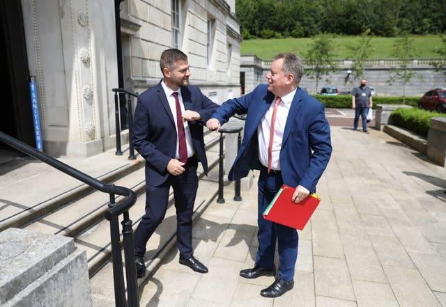 Colin McGrath from the SDLP and chairman of the Executive Office Committee greets Brexit minister Lord Frost