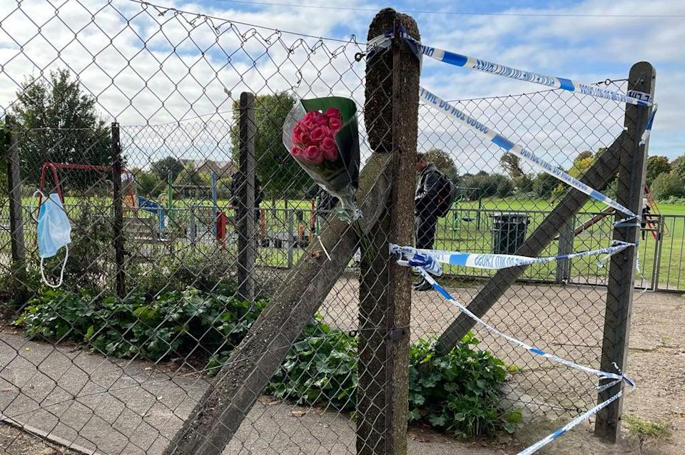 A floral tribute left at the entrance to a playing field in Craneford Way, Twickenham (Sophie Wingate/PA) (PA Wire)