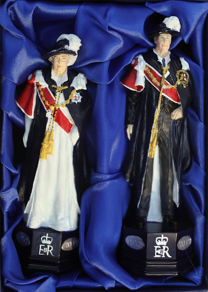 LONDON, ENGLAND - JANUARY 24:  King and Queen chess pieces modelled on the British Royal family from a 'Studio Anne Carlton' set commemorating the Queen's Diamond Jubilee at  the 2012 London Toy Fair at Olympia Exhibition Centre on January 24, 2012 in London, England. The annual fair which is organised by the British Toy and Hobby Association, brings together toy manufacturers with retailers from around the world.  (Photo by Oli Scarff/Getty Images)