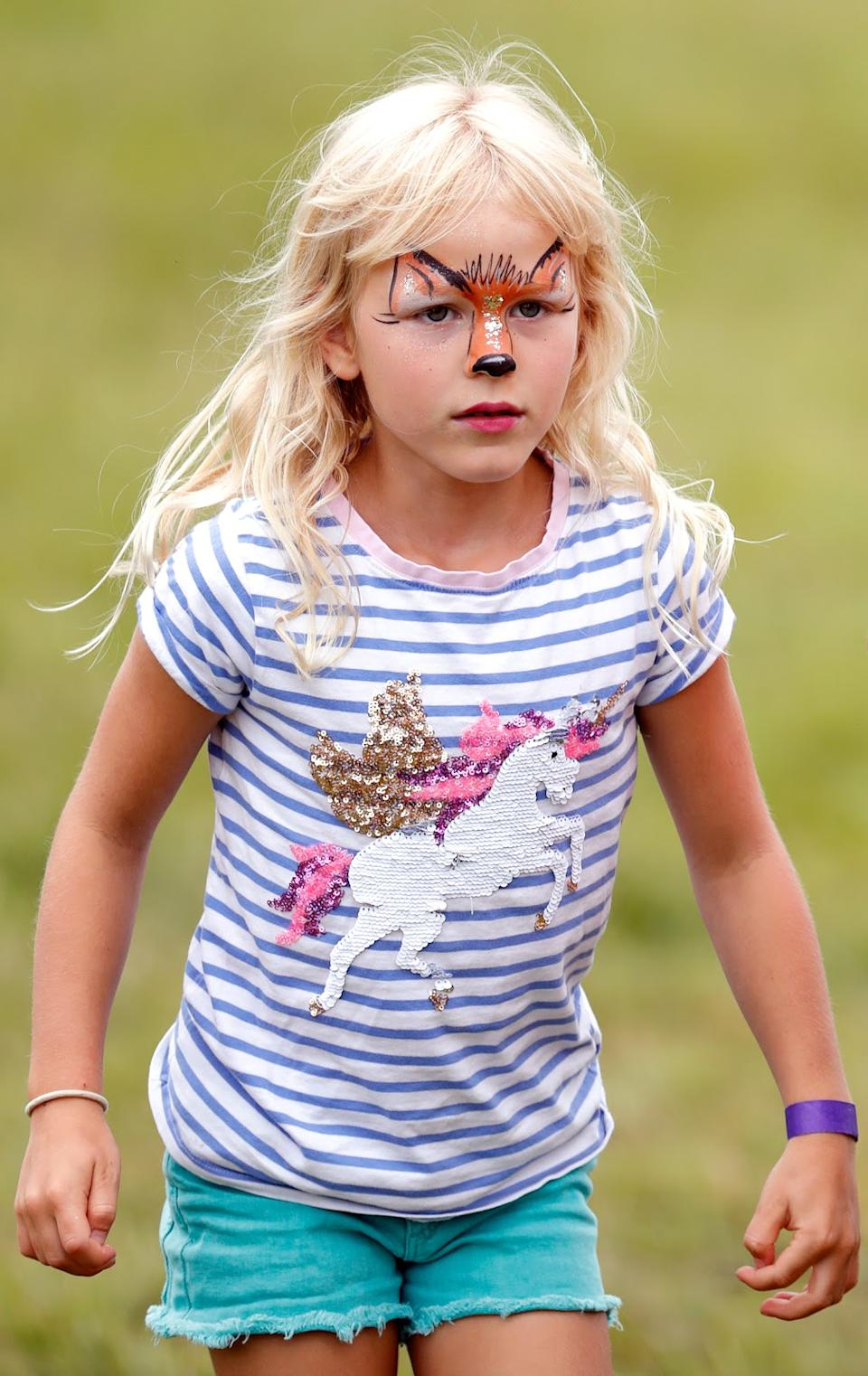 <p>Isla Phillips, wearing animal design face paint, at the 2019 Festival of British Eventing at Gatcombe Park. (Max Mumby/Indigo/Getty Images)</p>