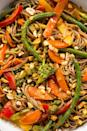 """<p>We're going (pea)NUTS for this Thai-inspired sauce.</p><p>Get the <a href=""""https://www.delish.com/uk/cooking/recipes/a28756736/rainbow-stir-fry-recipe/"""" rel=""""nofollow noopener"""" target=""""_blank"""" data-ylk=""""slk:Rainbow Stir-Fry"""" class=""""link rapid-noclick-resp"""">Rainbow Stir-Fry</a> recipe.</p>"""