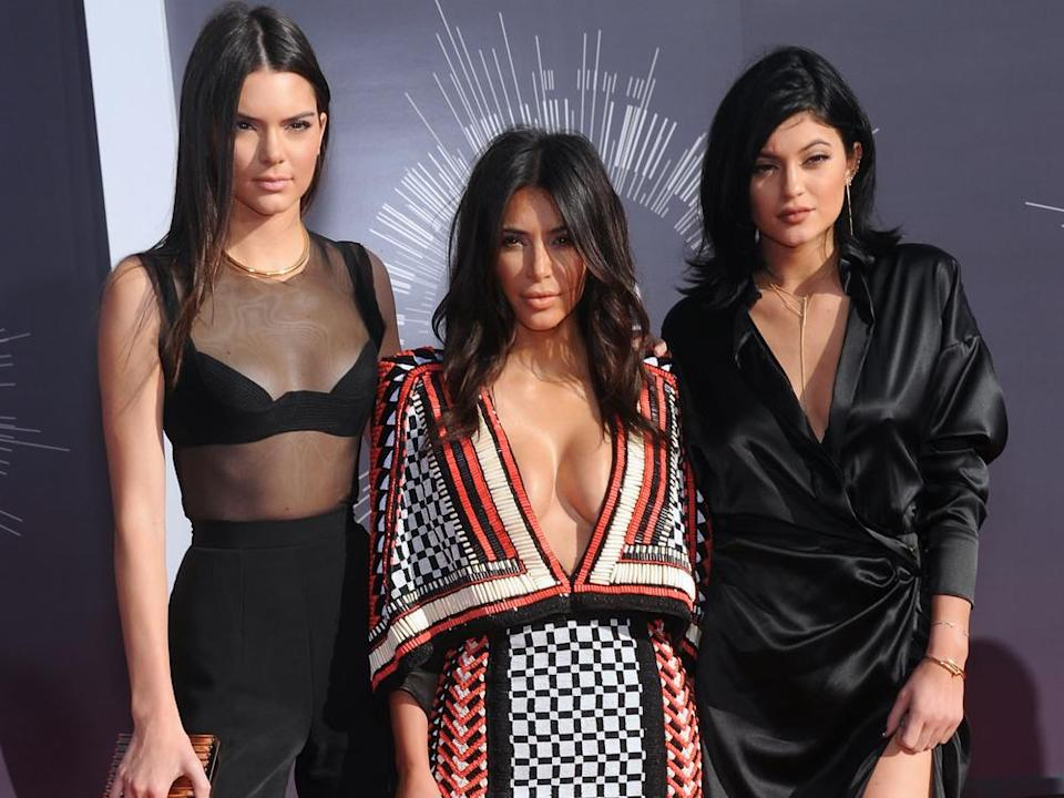 Kendall Jenner, Kim Kardashian and Kylie Jenner (from left to right) on the red carpet in 2014. (Image: DFree / Shutterstock.com)