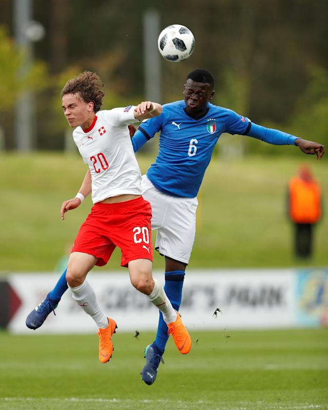 Soccer Football - UEFA European Under-17 Championship - Group A - Italy v Switzerland - St George's Park, Burton Upon Trent, Britain - May 4, 2018 Italys' Paolo Gozzi Iweru in action with Switzerland's Ruwen Werthmuller Action Images via Reuters/Lee Smith