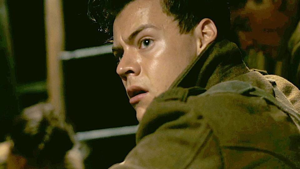 Harry Styles looks nervously over his shoulder in a scene from Dunkirk.