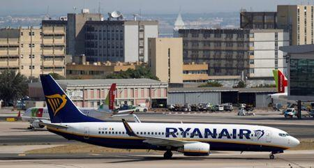 FILE PHOTO: A Ryanair Boeing 737-800 plane taxis at Lisbon's airport, Portugal September 27, 2018. REUTERS/Rafael Marchante/File Photo
