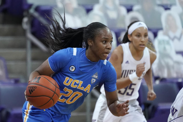UCLA guard Charisma Osborne (20) drives against Washington during the second half of an NCAA college basketball game, Sunday, Feb. 7, 2021, in Seattle. (AP Photo/Ted S. Warren)