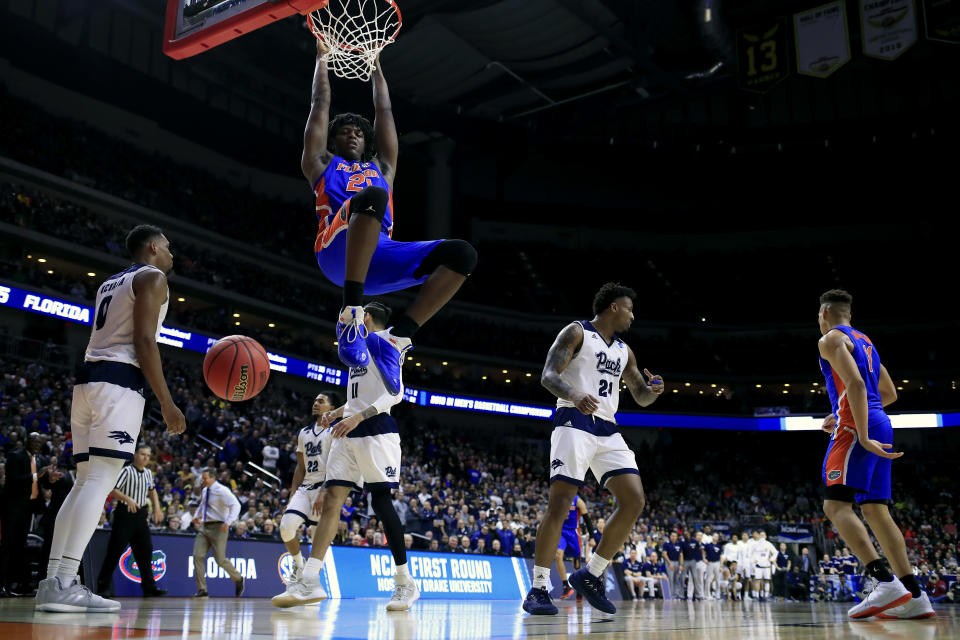 <p>Dontay Bassett #21 of the Florida Gators dunks the ball against the Nevada Wolf Pack in the second half during the first round of the 2019 NCAA Men's Basketball Tournament at Wells Fargo Arena on March 21, 2019 in Des Moines, Iowa. </p>