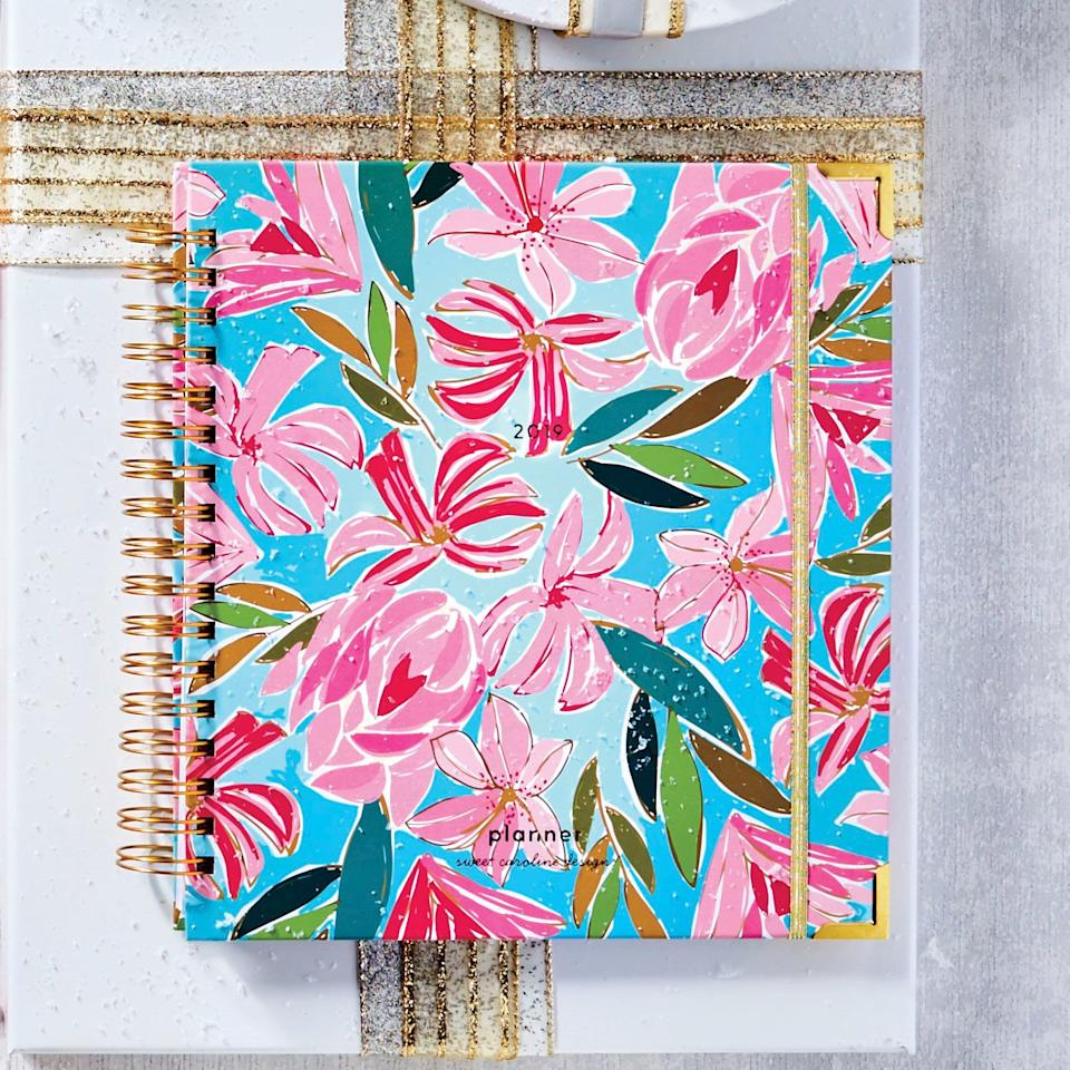 """<p>Scheduling meetings is more fun when you're plotting them in a colorful agenda, designed by Louisiana artist Caroline Hernandez.</p> <p><strong>Buy It: </strong>find similar styles at <a href=""""https://sweetcarolinedesigns.com/shop/planners/"""" target=""""_blank"""">sweetcarolinedesigns.com</a></p>"""