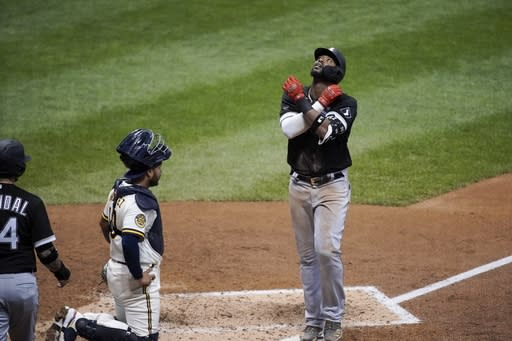 Chicago White Sox's Eloy Jimenez reacts as he crosses home after hitting a two-run home run during the sixth inning of a baseball game against the Milwaukee Brewers Tuesday, Aug. 4, 2020, in Milwaukee. (AP Photo/Morry Gash)