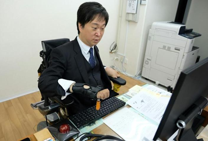 Shinya Ando, founder of Personal Assistant Machida in Japan, wants to see inclusion rather than just acceptance of people with disabilities (AFP Photo/Kazuhiro NOGI)