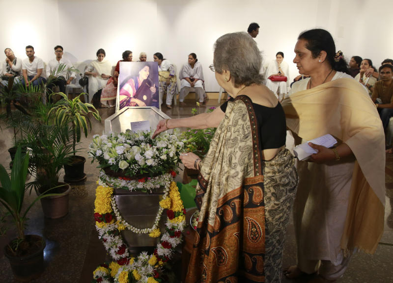 Elderly Indian women pays their last respects to classical Indian musician Kishori Amonkar in Mumbai, India, Tuesday, April 4, 2017. Amonkar, renowned for her innovative interpretation of classical Indian music, has died, one of her students said Tuesday. She was 84. (AP Photo/Rafiq Maqbool)