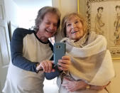 Leland Stein, left, takes a photo with his mother Sondra Green in her apartment in New York on April 26, 2018. The two are reuniting in person for Mother's Day as vaccinations have made families feel more comfortable gathering for the holiday. (Leland Stein via AP)