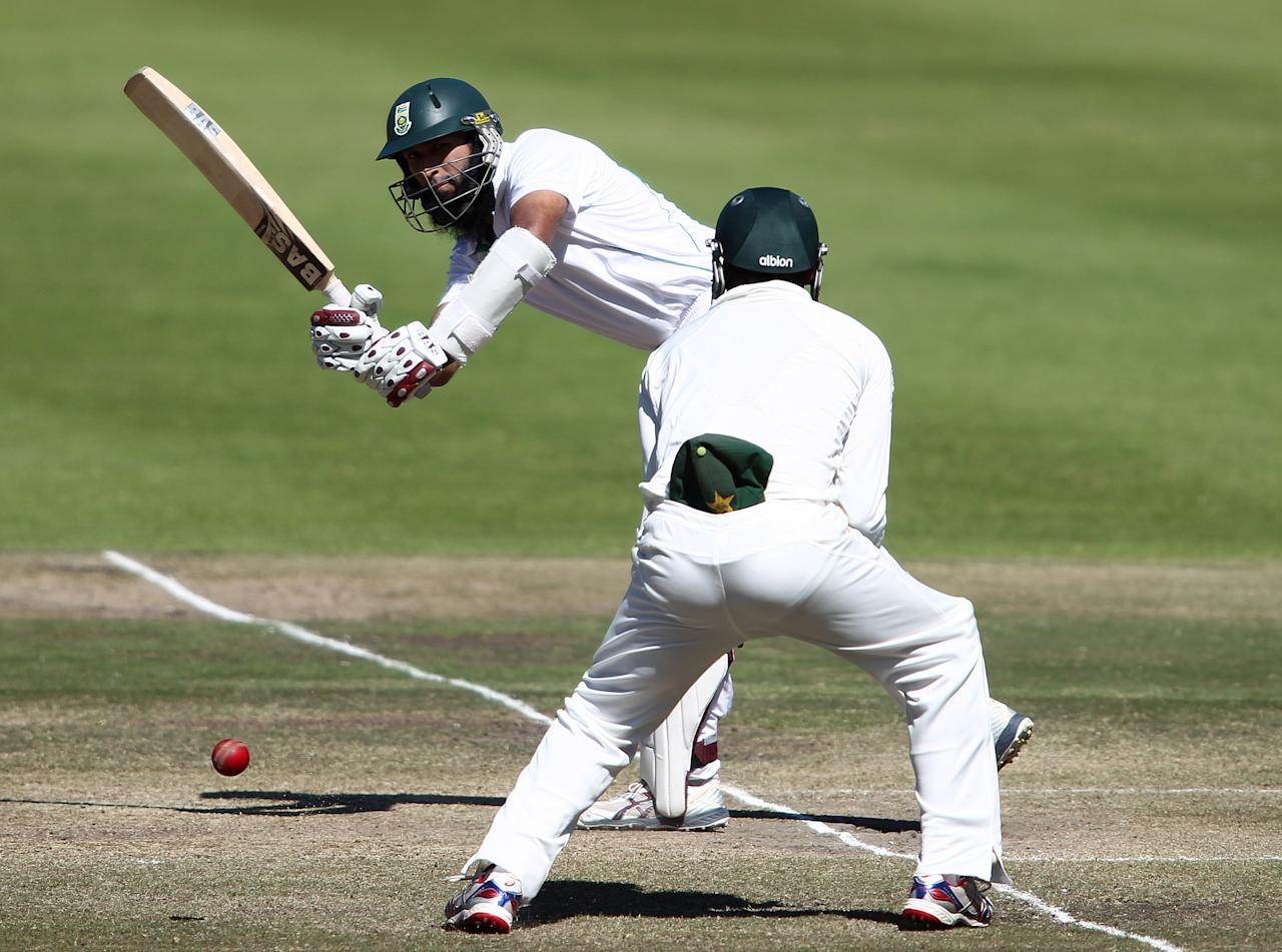 CAPE TOWN, SOUTH AFRICA - FEBRUARY 17: Hashim Amla of South Africa plays a delivery past short leg during day 4 of the 2nd Sunfoil Test match between South Africa and Pakistan at Sahara Park Newlands on February 17, 2013 in Cape Town, South Africa. (Photo by Shaun Roy/Gallo Images/Getty Images)