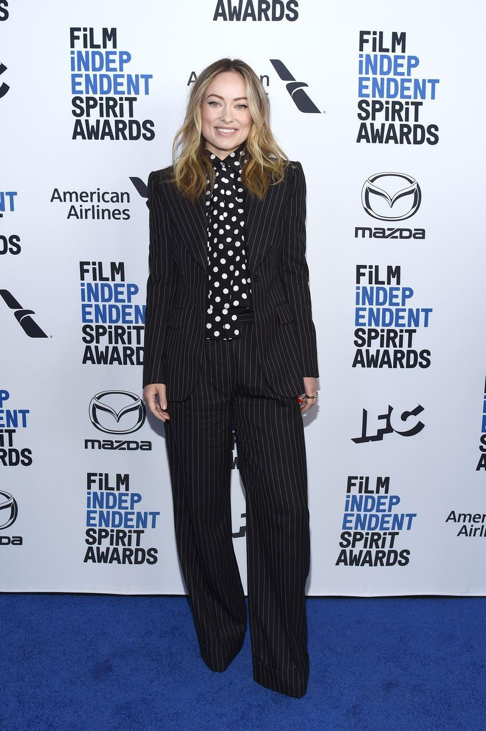 <p>Wilde decided to wear a black pinstripe suit and a black and white polka dot high-neck blouse for the blue carpet at the BOA Steakhouse in West Hollywood. </p>