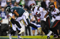 Philadelphia Eagles quarterback Jalen Hurts scores a touchdown during the second half of an NFL football game against the Tampa Bay Buccaneers on Thursday, Oct. 14, 2021, in Philadelphia. (AP Photo/Matt Slocum)
