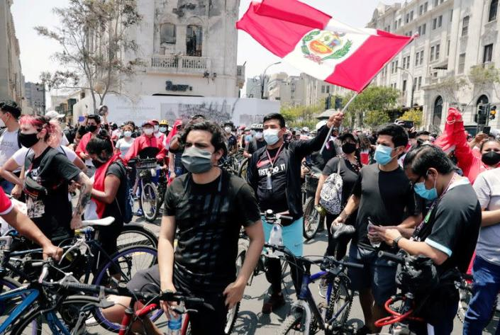 Peruvians take to the streets and celebrate after interim President Manuel Merino resigned in a television address, in Lima