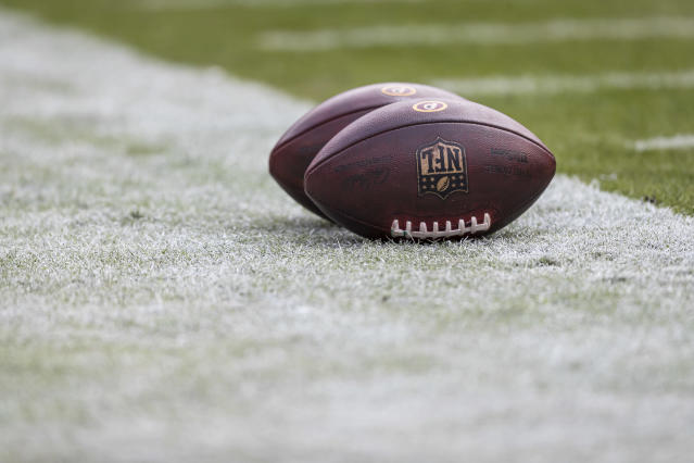 """LANDOVER, MD - NOVEMBER 24: A detailed view of two official NFL footballs with <a class=""""link rapid-noclick-resp"""" href=""""/nfl/teams/washington/"""" data-ylk=""""slk:Washington Redskins"""">Washington Redskins</a> logos on the sidelines before the game between the Washington Redskins and the <a class=""""link rapid-noclick-resp"""" href=""""/nfl/teams/detroit/"""" data-ylk=""""slk:Detroit Lions"""">Detroit Lions</a> at FedExField on November 24, 2019 in Landover, Maryland. (Photo by Scott Taetsch/Getty Images)"""