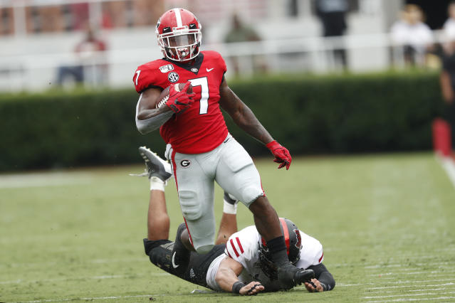 Georgia running back D'Andre Swift (7) brats free from Arkansas State defensive back Darreon Jackson (34) as he runs for a touchdown after a catch in the first half of an NCAA college football game Saturday, Sept. 14, 2019, in Athens, Ga. (AP Photo/John Bazemore)