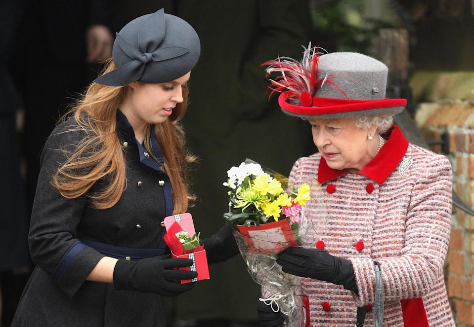 Princess Beatrice helped out her grandmother, the Queen, by holding on to her flowers in 2008. Photo: Getty Images